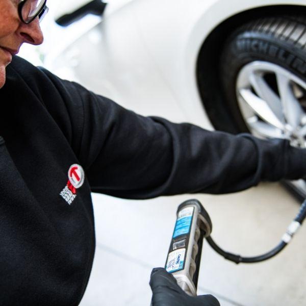 Checking tyre pressure in workshop