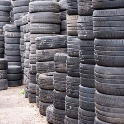 part worn tyres stacked in warehouse