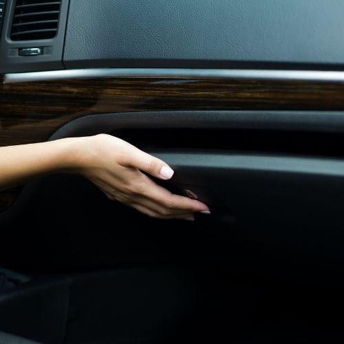 lady opening car glove box