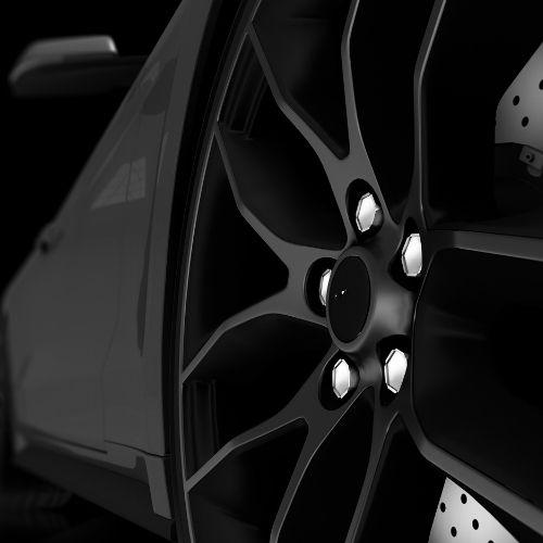 Locking wheel nuts on black alloy wheel