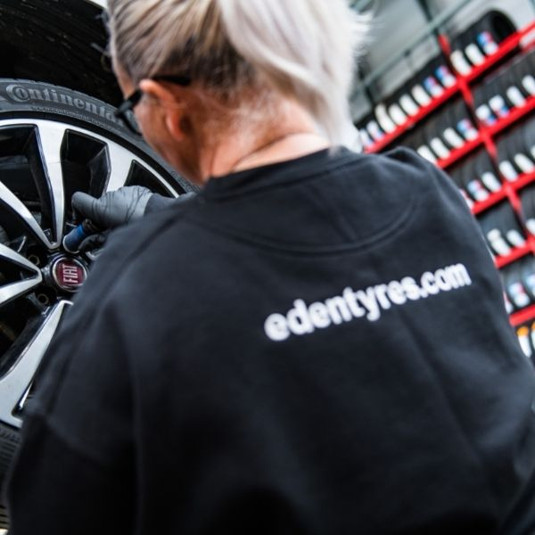 Lady fitting Continental tyre