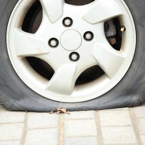 flat tyre on car
